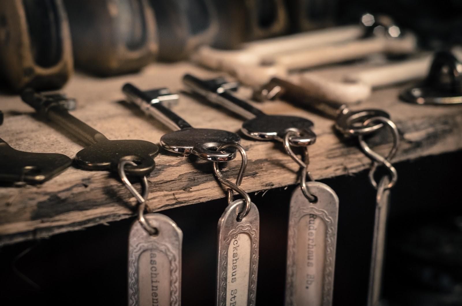 keys hanging on a wood piece
