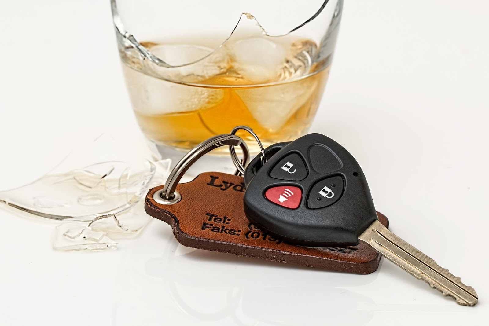 car key next to a drink