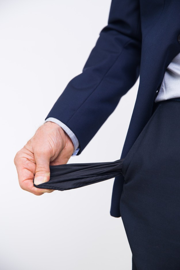 a person wearing a suit emptying his pockets to avoid losing his car keys