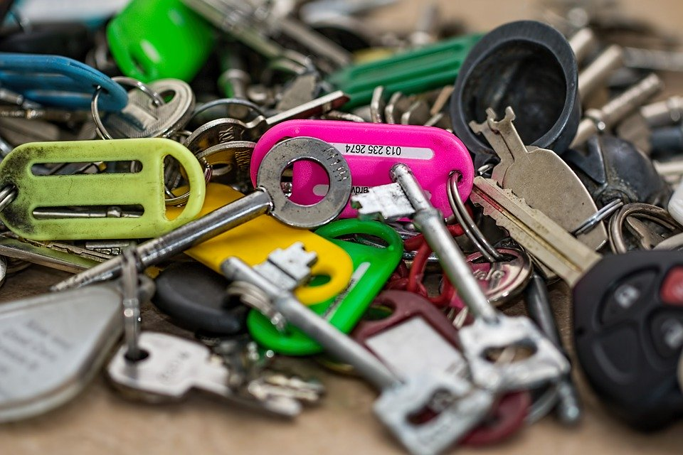 a pink key chain stands out among other keys. This can help a person locate their key