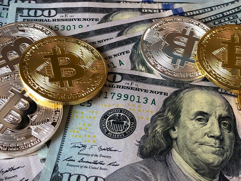 Bitcoins and US Dollar bills