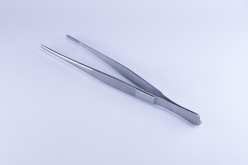 A pair of silver tweezers