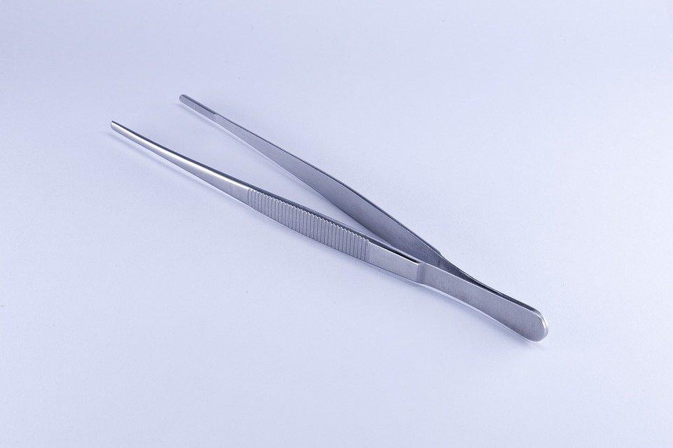 A pair of silver tweezers