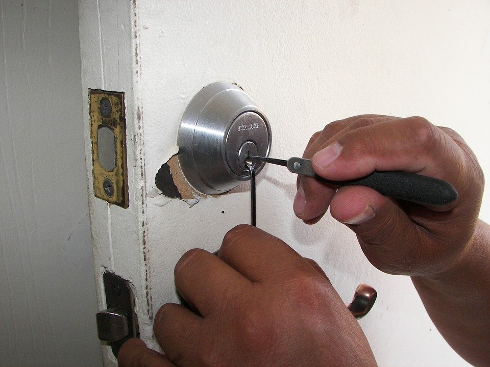 A locksmith taking out a broken key