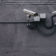 Two gray security cameras